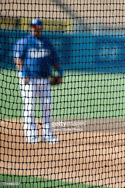 Juan Uribe of the Los Angeles Dodgers warms up behind the batting cage before a game on July 2 2012 at Dodger Stadium in Los Angeles California