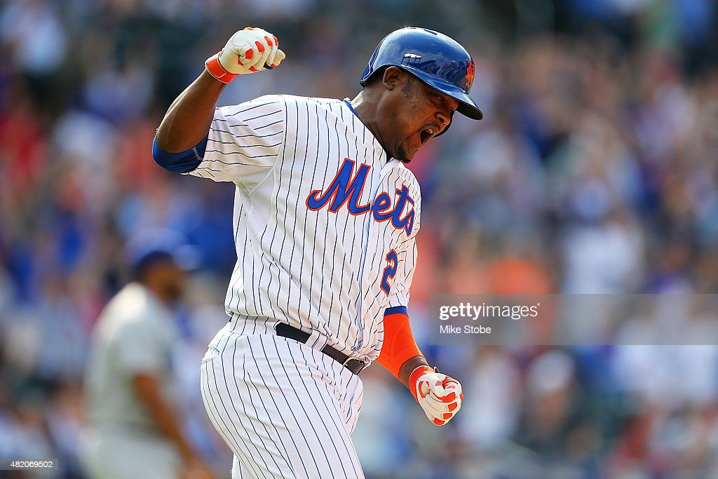 Juan Uribe #2 of the New York Mets celebrates after hitting a game winning walk-off RBI single against the Los Angeles Dodgers in the tenth inning at Citi Field on July 26, 2015 in Flushing neighborhood of the Queens borough of New York City. Mets defeated the Dodgers 3-2 in ten inning.