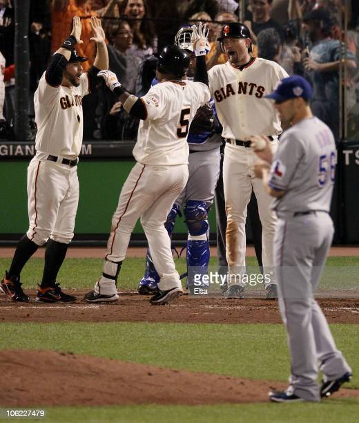 Juan Uribe of the San Francisco Giants hits a three run homerun in the fifth inning against Darren O'Day of the Texas Rangers in Game One of the 2010...
