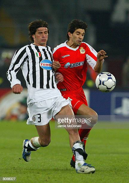 Juan Valeron of Deporivo and Alessio Tacchinardi of Juventus watch the ball during the UEFA Champions League Second Leg match between Juventus and...