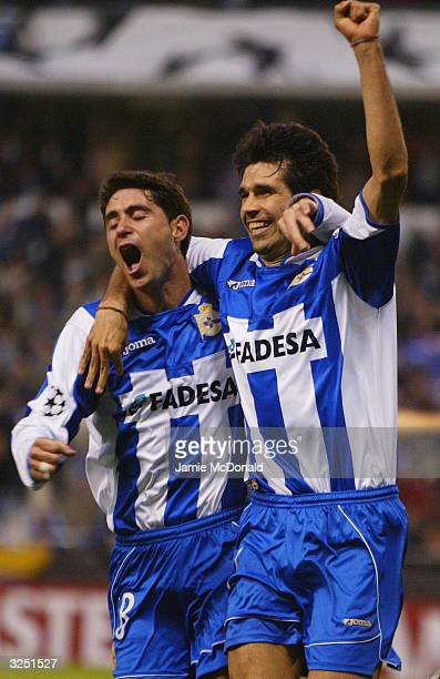 Juan Valeron of Deportivo celebrates his goal with Victor during the UEFA Champions League match between Deportivo La Coruna and AC Milan at the...