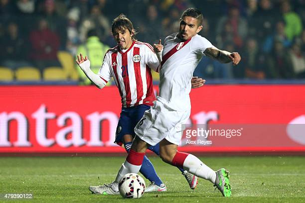 Juan Vargas of Peru fights for the ball with Oscar Romero of Paraguay during the 2015 Copa America Chile Third Place Playoff match between Peru and...