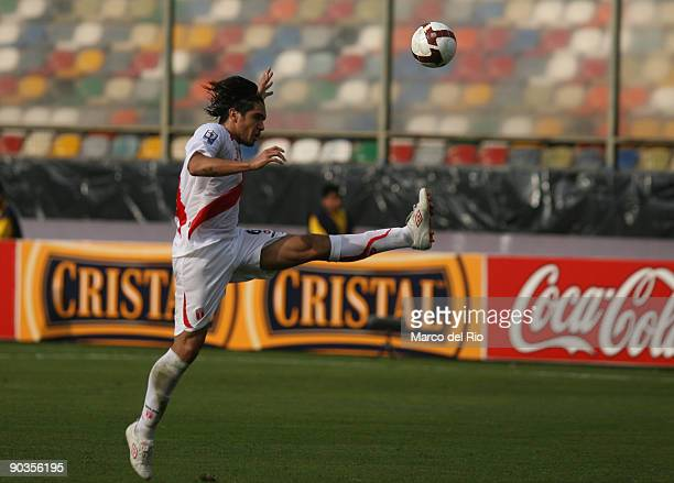 Juan Vargas of Peru vies for the ball with Sebastian Eguren of Uruguay during their FIFA World Cup 2010 Qualifier at Monumental Stadium on September...