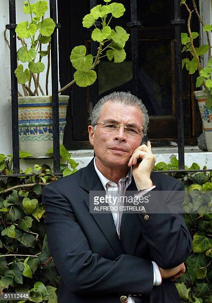 Juan Velazquez lawyer of Mexican ex president Luis Echeverria Alvarez speaks on a mobile phone at former head of state's house 24 July 2004 in Mexico...