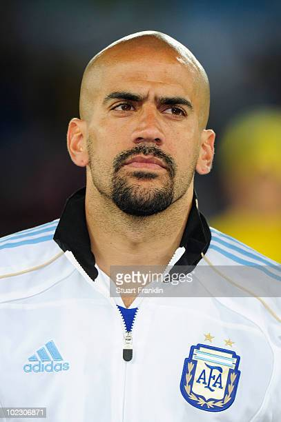 Juan Veron of Argentina lines up for the national anthems prior to the 2010 FIFA World Cup South Africa Group B match between Greece and Argentina at...