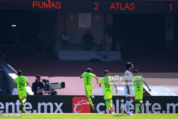 Juan Vigón of Atlas celebrates after scoring the second goal with his teammates during the 3rd round match between Pumas UNAM and Atlas as part of...