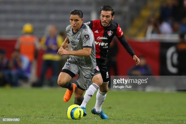 Juan Vigon of Atlas fights for the ball with Efrain Velarde of Monterrey during the 9th round match between Atlas and Monterrey as part of the Torneo...