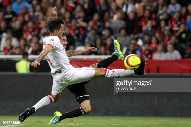 TOPSHOT Juan Vigon of Atlas vies for the ball with Maximiliano Perg of Toluca during their Mexican Clausura 2018 tournament football match at the...