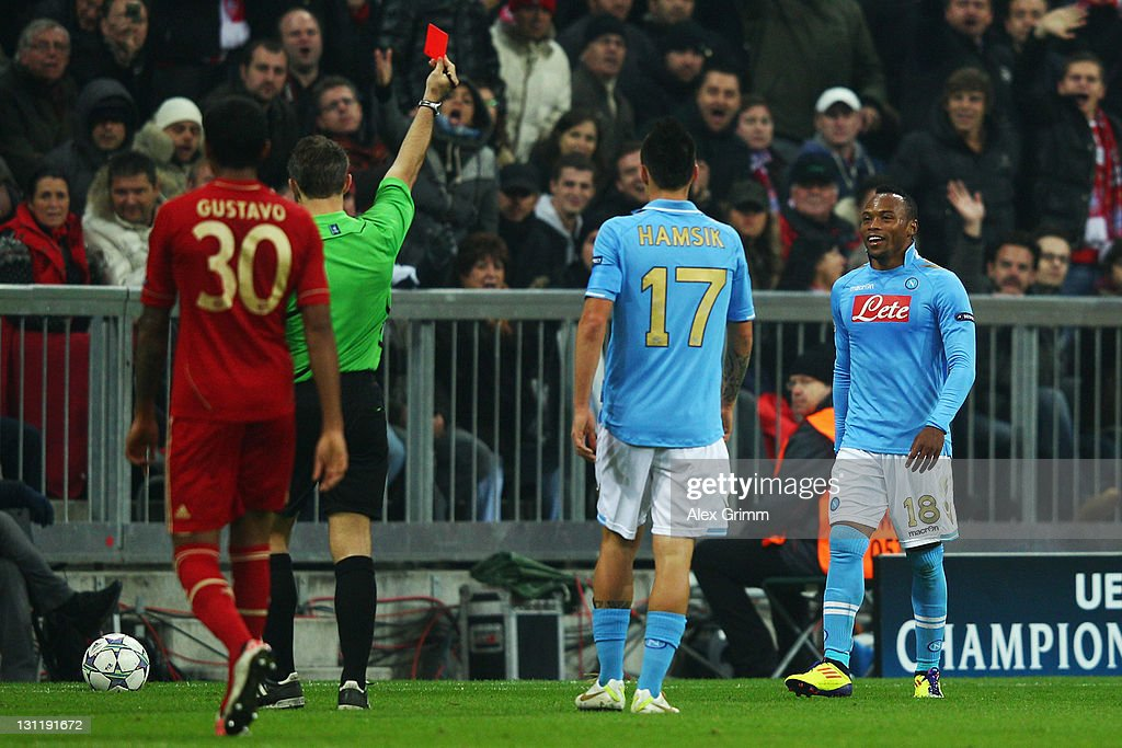 Juan Zuniga (R) of Napoli is sent off by referee Bjoern Kuipers during the UEFA Champions League group A match between FC Bayern Muenchen and SSC Napoli at Allianz Arena on November 2, 2011 in Munich, Germany.