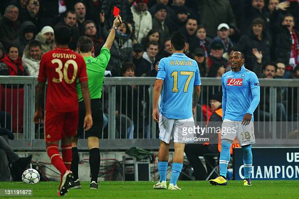 Juan Zuniga of Napoli is sent off by referee Bjoern Kuipers during the UEFA Champions League group A match between FC Bayern Muenchen and SSC Napoli...
