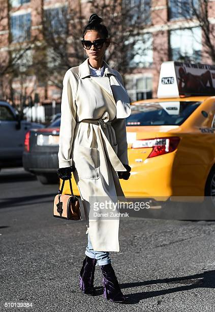 Juana Burga is seen outside the Tibi show wearing a white coat during New York Fashion Week Women's Fall/Winter 2016 on February 13 2016 in New York...