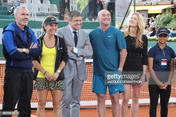 JuanCarlos Capell president of Longlines poses with former tennis players Steffi Graf and Andre Agassi Alex Corretja Arantxa Sanchez as they take...
