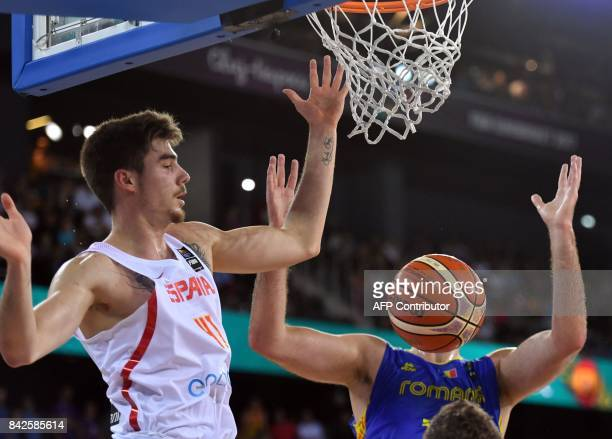 Juancho Hernangomez of Spain vies with Rolland Torok of Romania during Group C of the FIBA Eurobasket 2017 mens basketball match between Spain and...
