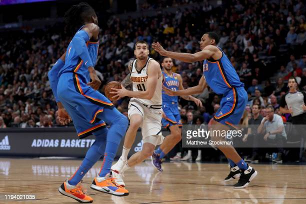 Juancho Hernangomez of the Denver Nuggets drives against Nerlens Noel and Darius Bazley of the Oklahoma City Thunder in the third quarter at Pepsi...