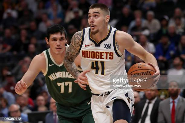 Juancho Hernangomez of the Denver Nuggets drives to the basket against Brook Lopez of the Milwaukee Bucks in the first quarter at the Pepsi Center on...