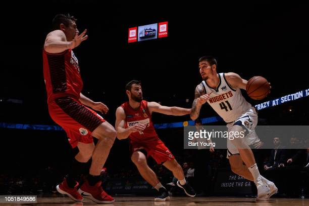 Juancho Hernangomez of the Denver Nuggets handles the ball against the Perth Wildcats during a preseason game on October 5 2018 at Pepsi Center in...
