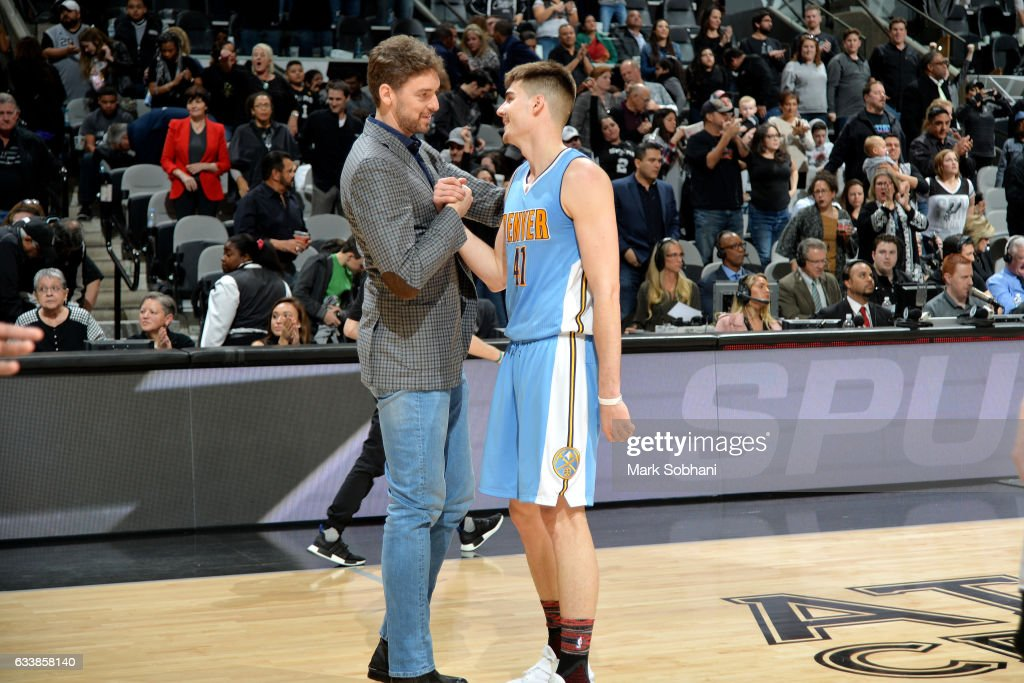 Juancho Hernangomez #41 of the Denver Nuggets shakes hands with Pau Gasol #16 of the San Antonio Spurs after the game on February 4, 2017 at the AT&T Center in San Antonio, Texas.