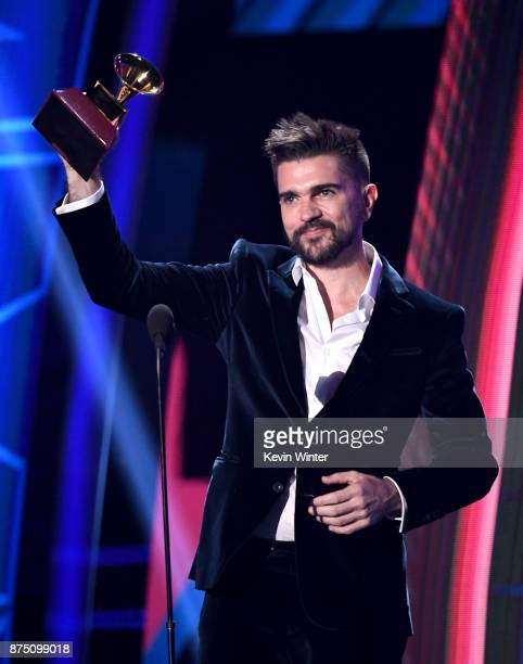 Juanes accepts Best Pop/Rock Album for 'Mis Planes Son Amarte' onstage at the 18th Annual Latin Grammy Awards at MGM Grand Garden Arena on November...