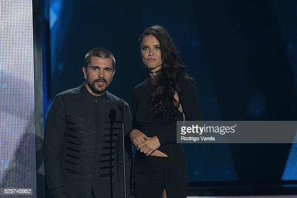 Juanes and Adriana Lima speak onstage at the Billboard Latin Music Awards at Bank United Center on April 28 2016 in Miami Florida