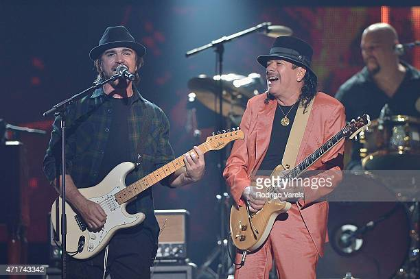 Juanes and Carlos Santana performs onstage at the 2015 Billboard Latin Music Awards presented bu State Farm on Telemundo at Bank United Center on...