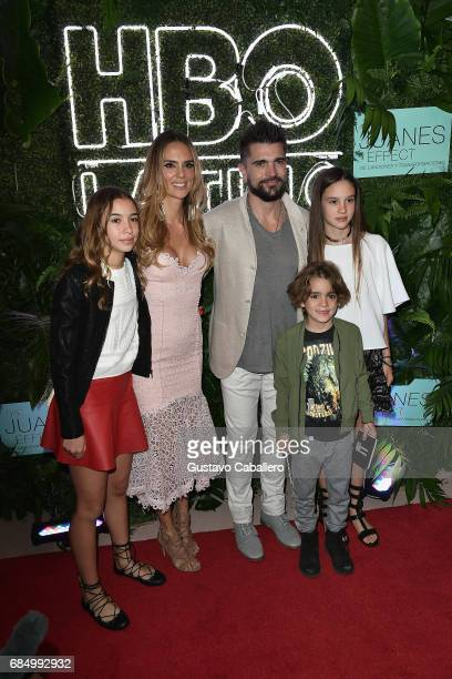 Juanes and his wife Karen Martinez pose with their children at the premiere of 'The Juanes Effect' at Faena Forum on May 18 2017 in Miami Beach...