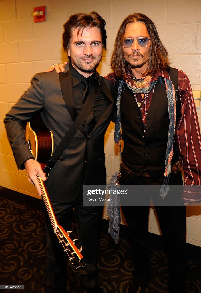 Juanes and Johnny Depp attend the 55th Annual GRAMMY Awards at STAPLES Center on February 10, 2013 in Los Angeles, California.
