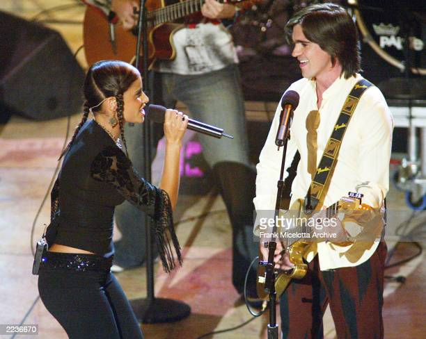 Juanes and Nelly Furtado perform live at The 3rd Annual Latin Grammy Awards held at the Kodak Theatre in Los Angeles Ca Sept 18 2002