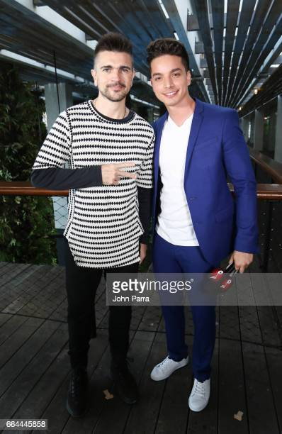 Juanes and Poyato pose backstage during his Screening Of 'Mis Planes Son Amarte' at Perez Art Museum Miami on April 3 2017 in Miami Florida