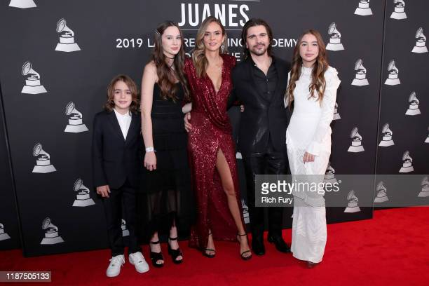 Juanes his wife Karen Martinez and their family attend the Latin Recording Academy's 2019 Person of the Year gala honoring Juanes at the Premier...