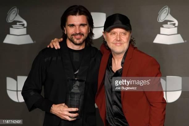 Juanes poses in the press room with his Person of the Year award with musician Lars Ulrich during the 20th Annual Latin Grammy Awards at MGM Grand...