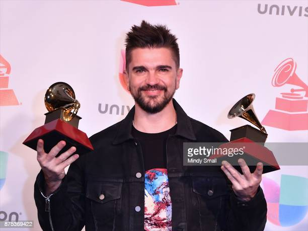 Juanes poses with awards for Best Pop/Rock Album and Best Engineered Album in the press room during The 18th Annual Latin Grammy Awards at MGM Grand...