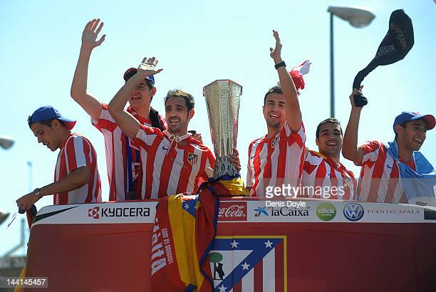 Juanfran and Gabi of Atletico Madrid celebrate with the Europa League trophy outside Vicente Calderon stadium a day after winning the Europa League...