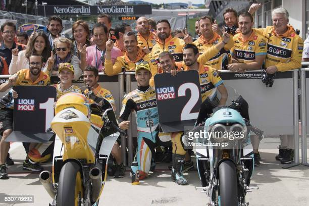 Juanfran Guevara of Spain and RBA BOE Racing Team and Gabriel Rodrigo of Argentina and RBA BOE Racing Team celebrate with team the Moto3 pole...