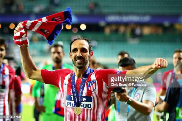 Juanfran of Atletico Madrid celebrates after winning the UEFA Super Cup between Real Madrid and Atletico Madrid at Lillekula Stadium on August 15,...