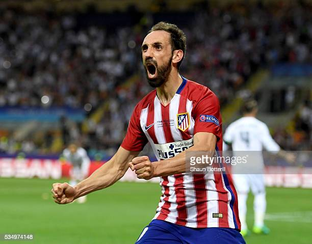 Juanfran of Atletico Madrid celebrates his sides equalising goal during the UEFA Champions League Final match between Real Madrid and Club Atletico...