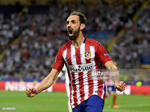Juanfran of Atletico Madrid celebrates his sides equalizing goal during the UEFA Champions League Final match between Real Madrid and Club Atletico...