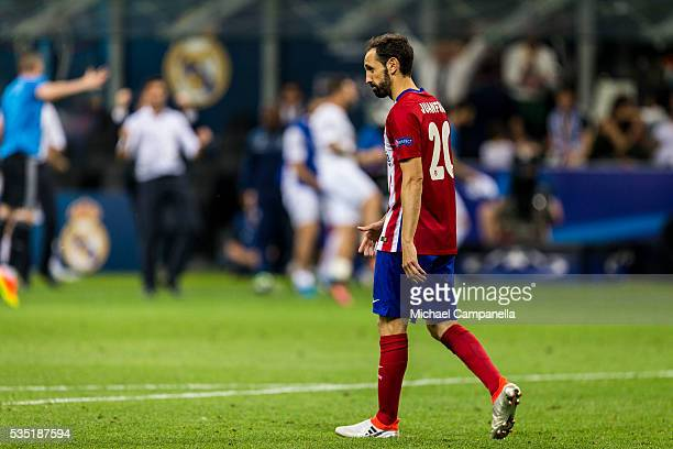 Juanfran of Atletico Madrid dejected after missing his penalty during the UEFA Champions League Final between Real Madrid and Atletico Madrid at...