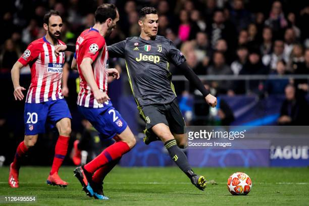 Juanfran of Atletico Madrid, Diego Godin of Atletico Madrid, Cristiano Ronaldo of Juventus during the UEFA Champions League match between Atletico...