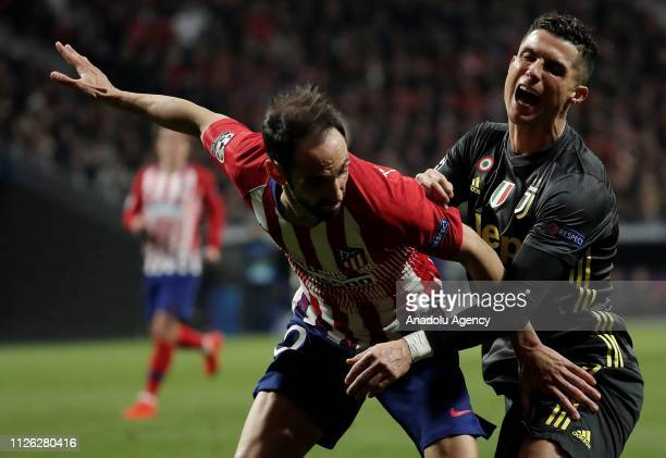 Juanfran of Atletico Madrid in action against Cristiano Ronaldo of Juventus during UEFA Champions League round of 16 soccer match between Atletico...