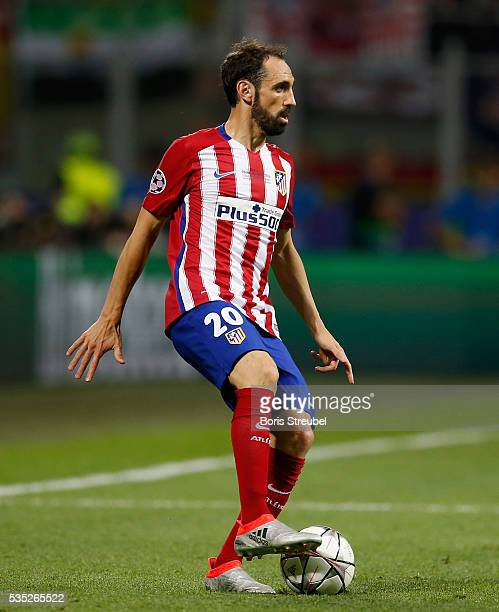 Juanfran of Atletico Madrid runs with the ball during the Champions League final match between Real Madrid and Club Atletico de Madrid at Stadio...