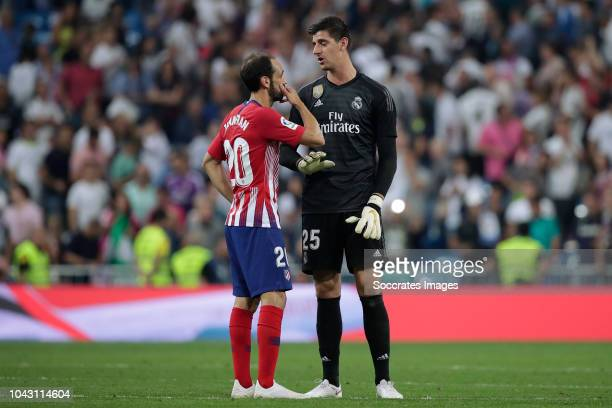 Juanfran of Atletico Madrid, Thibaut Courtois of Real Madrid during the La Liga Santander match between Real Madrid v Atletico Madrid at the Santiago...