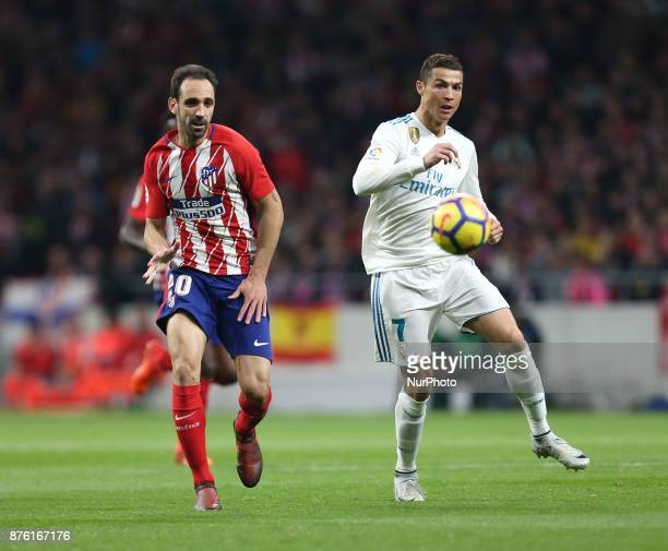 Juanfran of Atletico Madrid vies Cristiano Ronaldo of Real Madrid during the match between Atletico de Madrid and Real Madrid week 12 of La Liga at...