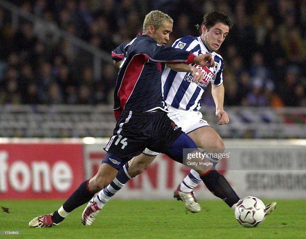 Juanfran of Celta Vigo and Kahveci Nihat of Real Sociedad in action...  Nachrichtenfoto - Getty Images