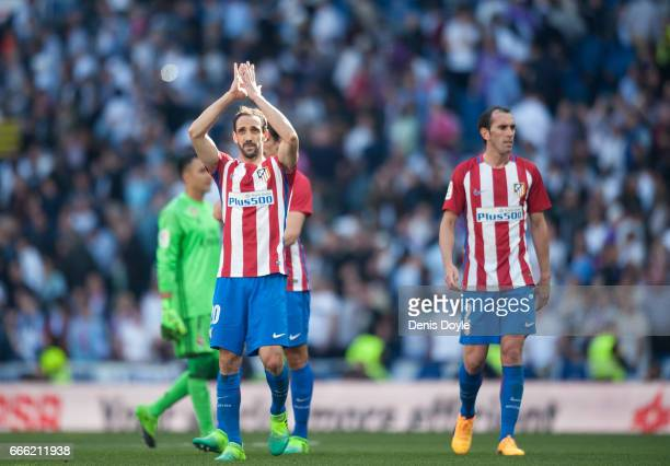 Juanfran of Club Atletico de Madrid celebrates with teamates at the end of the La Liga match between Real Madrid CF and Club Atletico de Madrid at...
