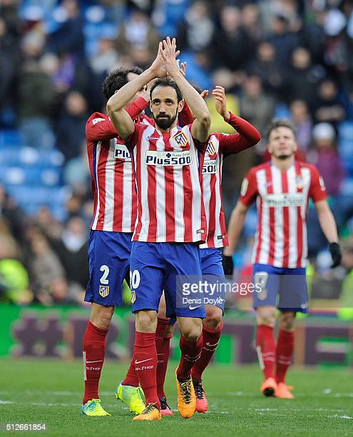 Juanfran of Club Atletico de Madrid celebrates with teammates after they beat Real 10 in the La Liga match between Real Madrid CF and Club Atletico...