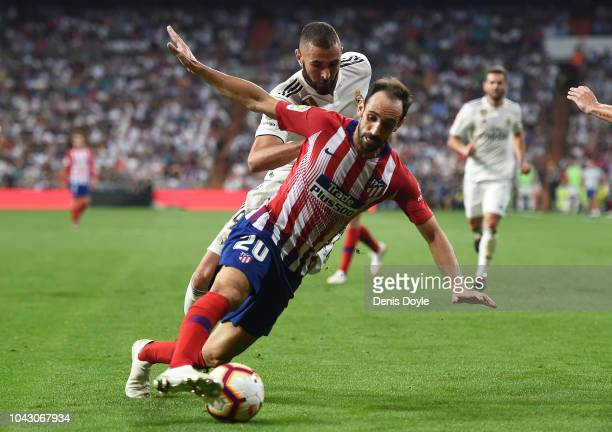 Juanfran of Club Atletico de Madrid cuts off Karim Benzema of Real Madrid during the La Liga match between Real Madrid CF and Club Atletico de Madrid...
