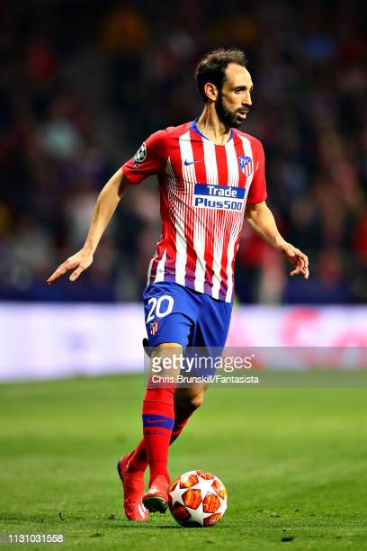 Juanfran of Club Atletico de Madrid in action during the UEFA Champions League Round of 16 First Leg match between Club Atletico de Madrid and...