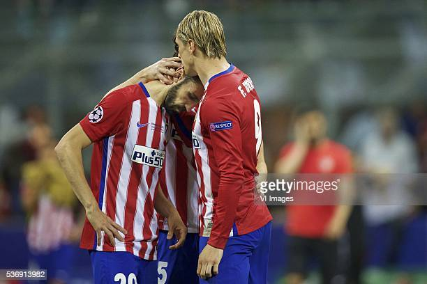 Juanfran of Club Atletico de Madrid Stefan Savic of Club Atletico de Madrid Fernando Torres of Club Atletico de Madrid during the UEFA Champions...