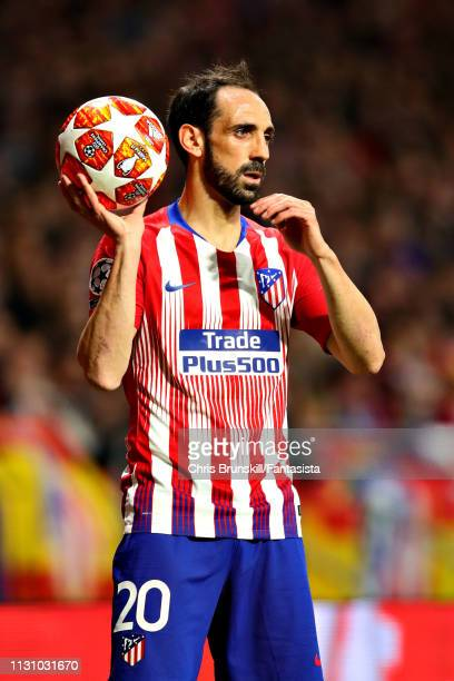 Juanfran of Club Atletico de Madrid takes a throw in during the UEFA Champions League Round of 16 First Leg match between Club Atletico de Madrid and...