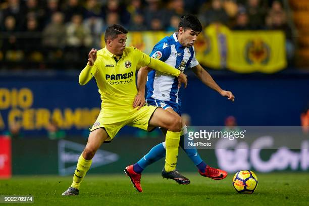 Juanfran of Deportivo de La Coruna competes for the ball with Pablo Formals of Villarreal CF during the La Liga game between Villarreal CF and...